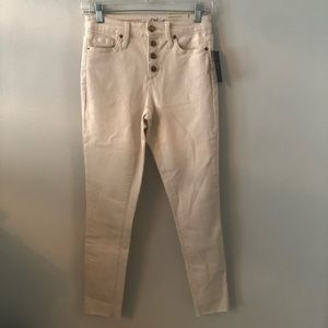 A cream colored pair of high-rise skinny jeans